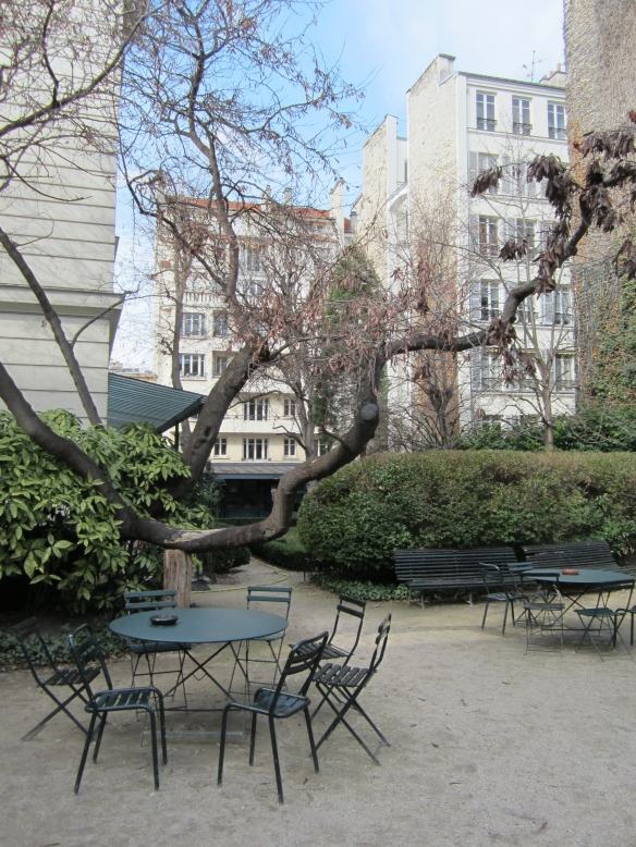 Courtyard seating at the Reid Center today. I wonder how old that tree is?