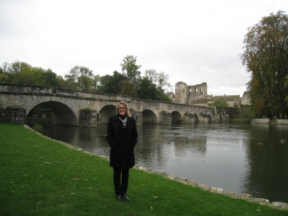 Standing in front of the bridge at Grez-sur-Loing in 2012.