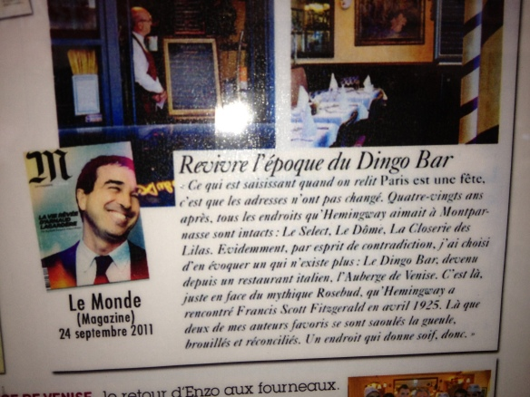 """In the window of L'Auberge de Venise is an article from La Monde titled """"Remembering the Epoque of the Dingo Bar.""""  It's hard for me to translate, but it says something like: this is where two of my favorite authors used to get blasted (""""drunk mouth""""), blurry and reconciled. A place to make you thirsty, for sure."""