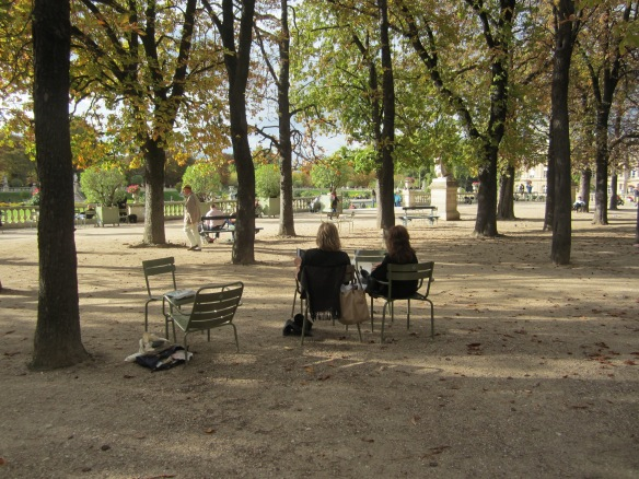 My friends and I enjoying a fall day in my favorite Luxembourg chairs. For my fellow Francophiles: did you know you can order these chairs and have them shipped to the United States? Check out the website of Deyrolle at 46 rue de Bac in Paris. (Which just happens to be the same taxidermy shop filmed in Midnight in Paris.) If you can't find the chairs on their website, you can always try to email them. I came **this close** to ordering one for my husband last Christmas. We loved them that much.