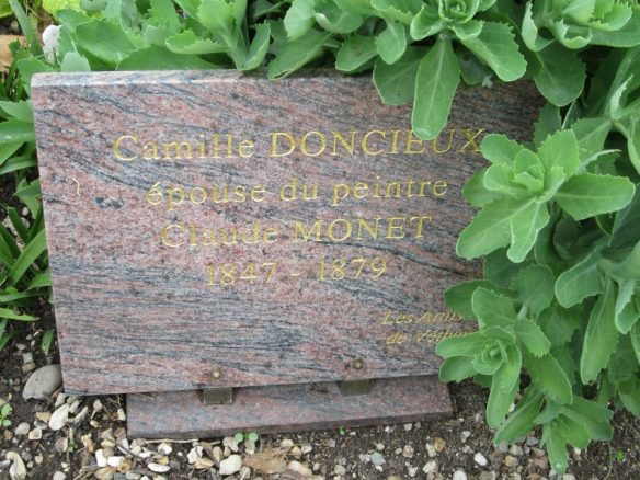 The new grave marker installed by a group of donors, Friends of Camille