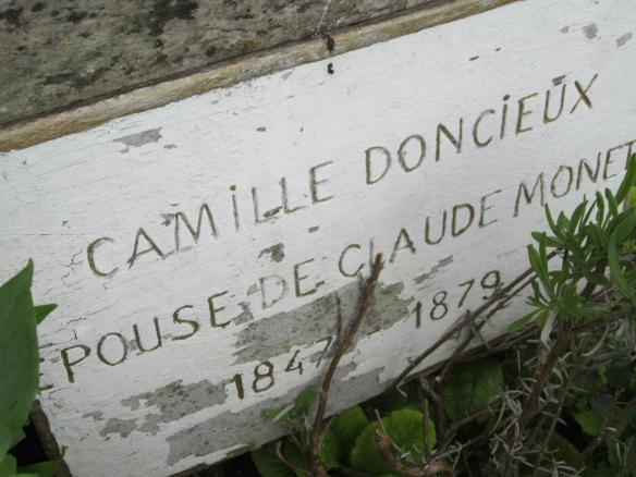 The old grave marker. There is no mention of her married name.