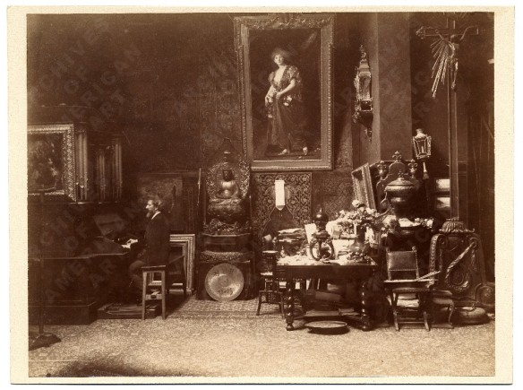 "A photo of Carolu-Duran playing the organ in his art studio (1885). From the image gallery at the American Archives of Art. Keenum gets it right when she describes the studio as being ""strewn with thick Persian rugs and hung with tapestries and pictures."""