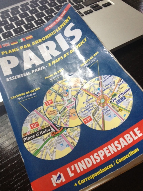 My dog-eared L'Indispensable Paris Arrodissement Map. My own personal Rosetta Stone.