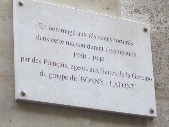 "The plaque outside the former 93 rue Lauriston in the 16th arrondissement of Paris. ""In homage to the resistants tortured in this house during the occupation 1940-1944 by the French agents, auxiliaries of the Gestapo, the group ""Bonny-LaFont"""