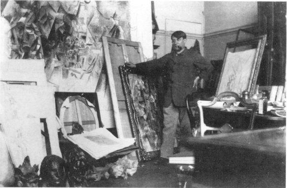 Pablo Picasso in his boulevard Clichy apartment/studio,