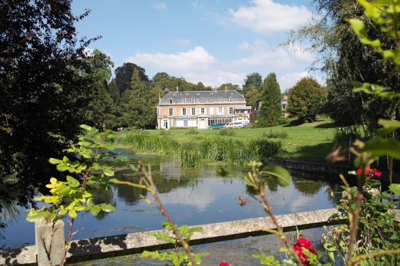 The view of Chateau Beaufresne from the back of the property, across a lovely little lilly pond.