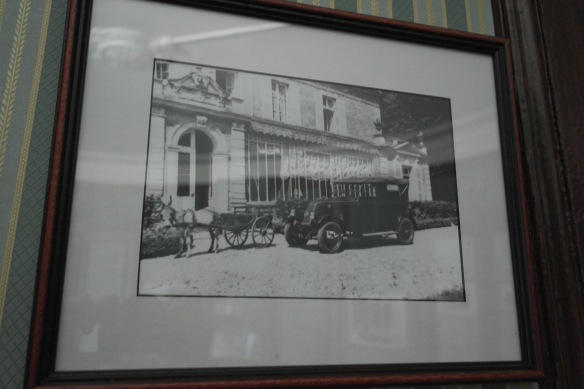 A framed photo on display in the chateau shows a car parked outside the back door in front of the gallery.