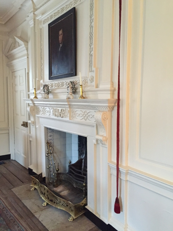 The fireplace in the drawing room of the Hayward-Washington House, next to which is a bell-pull for the attending house slaves.