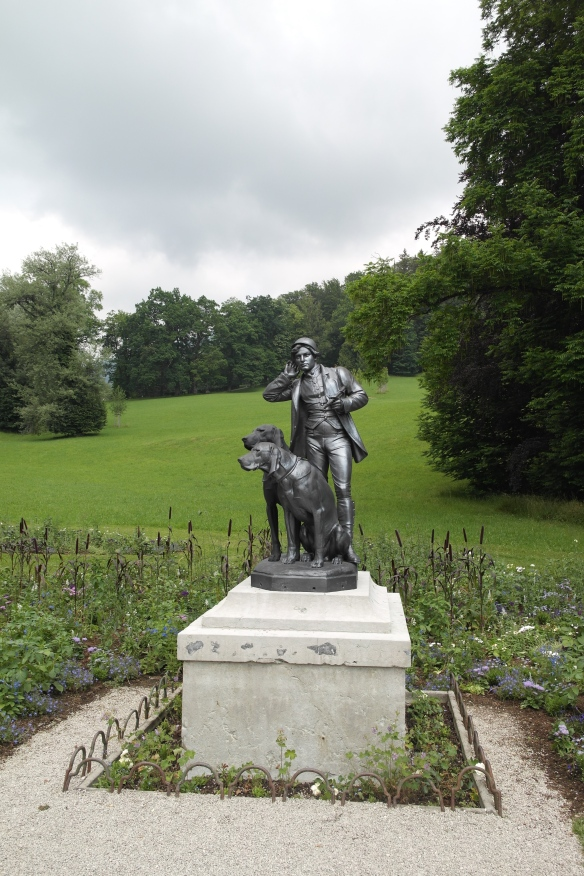 "A charming  huntsman statue, ""The Listener"" stands in the lawn in front of the grounds and gardens across from the villa. Emperor Frank Josef was a big hunter. The inside of the villa (no photos allowed) contains many hunting trophies, including antlers and deer heads."
